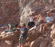 The field team excavates the first major quarry platform on the cliff where the fossil was found.