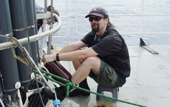 Photo of biologist Jeff Morris on a research vessel.