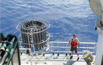 Photo of the launch of the instrument rosette that will take ocean water samples.