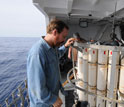 Image of marine chemist Ken Buesseler making a final inspection of a water-sampling rosette.