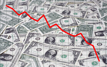 Illustration showing a pile of dollar bills and a red line going down