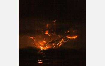 Photo of lightning in the clouds around a volcanic plume.