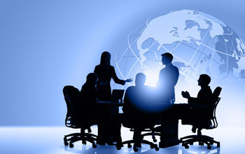 Illustration showing silhouettes sitting at a table with a globe in the background