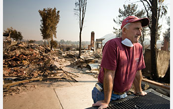 John Rossi helps friends recover from the devastating October 2007 fire that destroyed their home.