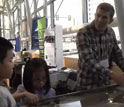 Image of Douglas Jerolmack of the University of Pennsylvania using a stream table to teach kids.