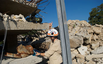 Photo of researcher Robin Murphy studying robot-human interactions during a disaster scenario.