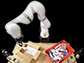 robotic arm packs items into a box