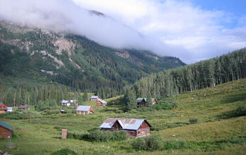 Photo of Gothic Mountain shrouded in clouds behind Colorado's Rocky Mountain Biological Laboratory.