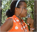 Mara Fonseca, 13 years old, recording observations of the monkeys' behavior