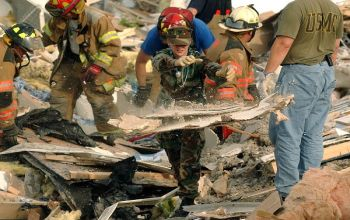 Rescuers clear rubble in Evansville, Ind.