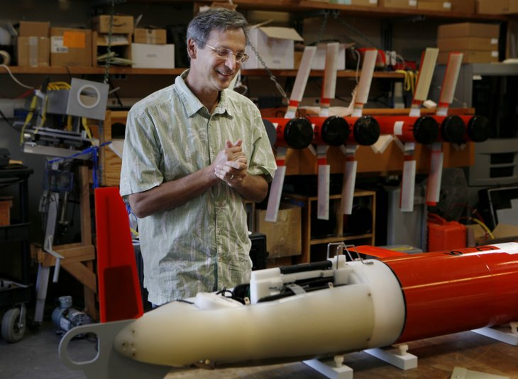 Oceanographer Dan Rudnick checks on a Spray glider before it sets forth on a mission.