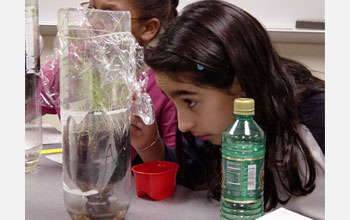 Photo of girl performing a science experiment.