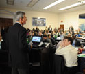 Image of Representative Daniel Lipinski speaking in front of a standing-room-only crowd.