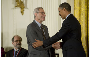 Photo of Michael Posner receiving the National Medal of Science from President Barack Obama.