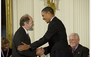 Photo of James Gunn receiving the National Medal of Science from President Barack Obama.