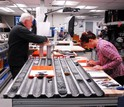 Twop scientists in a lab working on sediment cores
