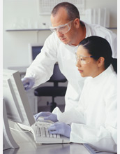 Photo of scientists collaborating at a computer.