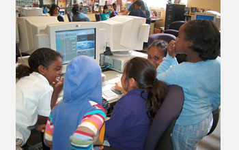 Photo of students using Scratch, an MIT-created programming language for children.