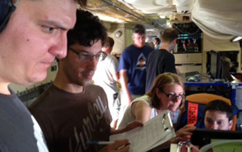 Researchers on a research plane with instruments