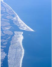 An aerial view of Long Island shows its low-lying shores, vulnerable to sea-level rise effects.