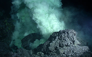 Lava erupts onto the seafloor at NW Rota-1, creating a cloudy, extremely acidic plume.