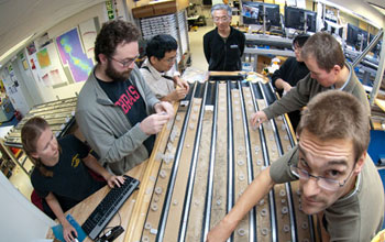 Photo of researchers working on the sediment cores.