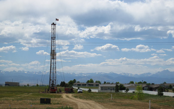 Photo of a workover rig completing a well near a surburban development in Weld County, Colo.