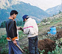 Photo shows Nepali workers and researchers setting up seismic stations.