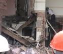 Researchers watch as an Indiana Task Force member enters the partially collapsed building.