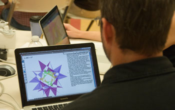 Photo of teacher John Sheridan viewing Geometer's Sketchpad on a laptop.