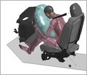 illustration of a simulated car crash with a human body model in the driver's seat