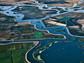 aerial image showing a network of levees and wetlands protect the low-lying agricultural communities