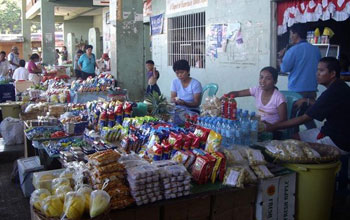 Photo of vendors selling their goods at an open air market in the Philippines.