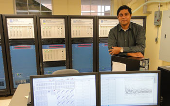 G. Kumar Venayagamoorthy in his lab, surrounded by computers