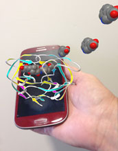 Illustration showing a smartphone and 3-d representations of the AIDS virus.