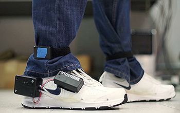 running shoes with electronic device attached