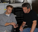 Photo: Scientists Noah Plavansky and Tim Lyons discuss attributes of a banded iron formation sample.