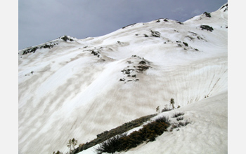 Photo showing zebra stripes of dust and snow on the snow surface in Colorado mountains.