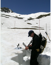 Photo of scientist Tom Painter tracking radiation in June, 2007.