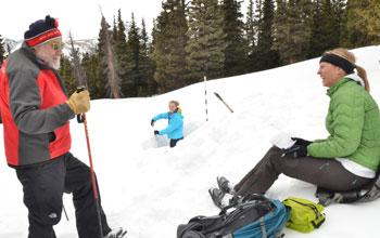 Scientist Mark Williams samples snow with help from Katya Hafich and Kendall Gotthelf.