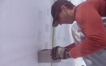 Photo of scientist Noah Molotch sampling snow density in a snow pit.