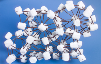 Photo showing marshmallows representing hairy spheres connected with plastic coffee stirrers.