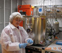 "Photo of Diane Hinkens in a ""clean room""."