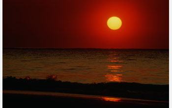 Image of the sun on the ocean's horizon.