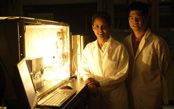 Photo of Sossina Haile and William Chueh next to the benchtop thermochemical reactor.