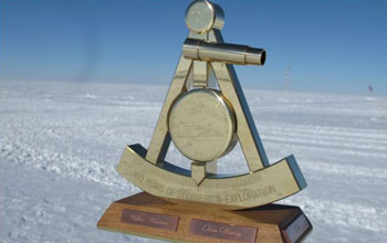 Image of the 2011 bronze marker at NSF's Amundsen-Scott South Pole Station.
