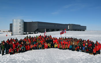 Photo of U.S. Antarctic Program personnel at the geographic South Pole on Dec. 14, 2011.