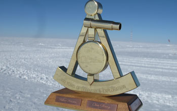 Photo of 2011 bronze marker designating the geographic South Pole.