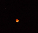 Lunar eclipse and stars in the sky