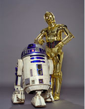 Photo of the famous droids C-3PO and R2-D2 in the Robots and People section of the exhibit.